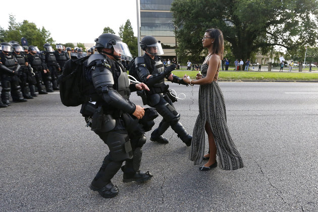 A demonstrator protesting the shooting death of Alton Sterling is detained by law enforcement near the headquarters of the Baton Rouge Police Department in Baton Rouge, Louisiana, U.S. July 9, 2016. REUTERS/Jonathan Bachman TPX IMAGES OF THE DAY